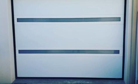 Porte de Garage Sectionnelle Visio Panoramique – LA TOULOUSAINE – Lagord (17400)